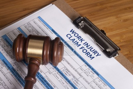 Photo for Claim form for a work injury on a desk top - Royalty Free Image