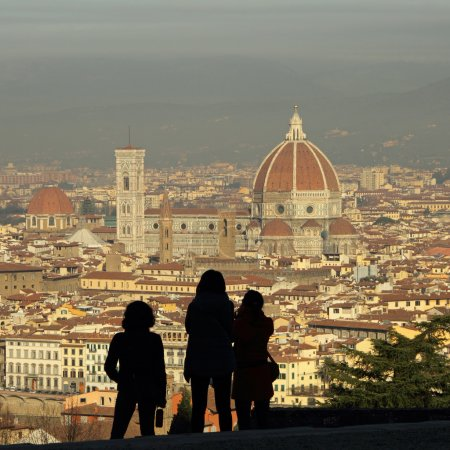 Photo for Silhouettes of tourists admiring fantastic view of Florence city seen from San Miniato al Monte, Italy, Europe - Royalty Free Image