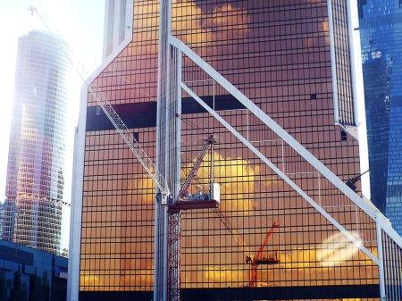 skyscraper under construction with crane