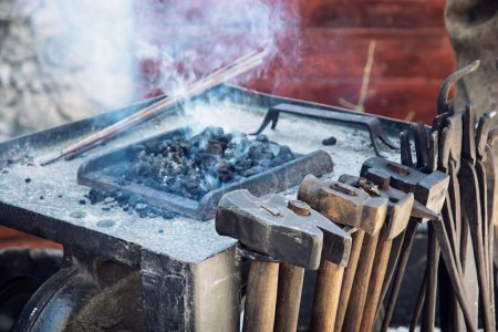 Photo for Old blacksmith tools in the historical manufactory. Burning embers. - Royalty Free Image
