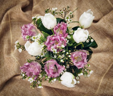 Bouquet of beautiful white and purple tulips, holiday symbol