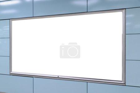 One big horizontal / landscape orientation blank billboard in public transport