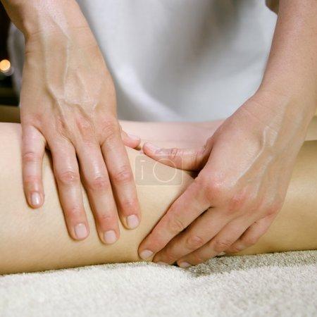 Closeup of legs massage in spa salon