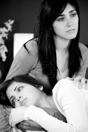 Two sisters deep sorrow caused by someone death