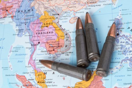 Photo for Four bullets on the geographical map of Thailand, Laos and Vietnam. Conceptual image for war, conflict, violence. - Royalty Free Image