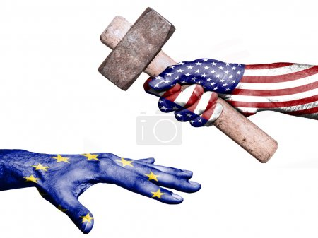 Photo pour Flag of United States overprinted on a hand holding a heavy hammer hitting a hand representing the European Union. Conceptual image for political, fiscal or social aggressions, penalties, taxation - image libre de droit