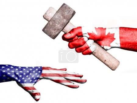 Photo pour Flag of Canada overprinted on a hand holding a heavy hammer hitting a hand representing the United States. Conceptual image for political, fiscal or social aggressions, penalties, taxation - image libre de droit