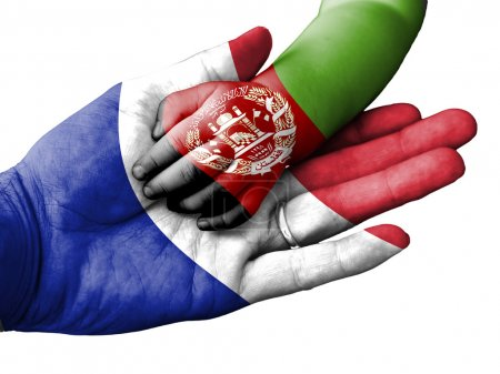 Photo pour Flag of France overlaid the hand of an adult man holding a baby hand with the flag of Afghanistan overprinted. Conceptual image for help, aid, assistance, rescue. Isolated on white background - image libre de droit