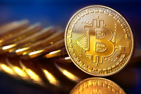 Photo for Photo Golden Bitcoins (new virtual money ) Close-up on a blue background. - Royalty Free Image