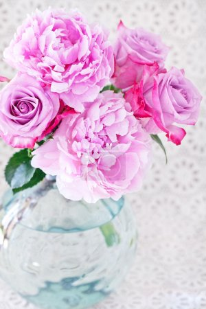 Pink peony and roses