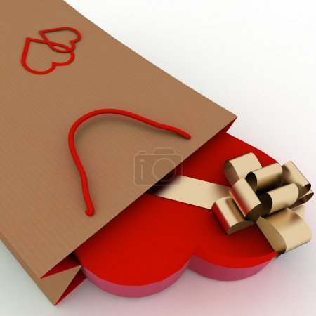 Box as heart form with a gold bow in a bag for a gift