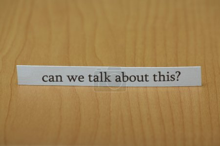 Photo for The question can we talk about this typed on a strip of paper left standing on a wooden desktop - Royalty Free Image