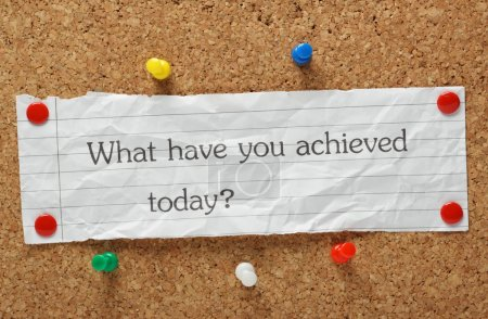 Photo for The question What have you achieved today? typed on a piece of crumpled paper pinned to a cork notice board - Royalty Free Image