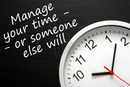 Photo for The phrase Manage your time - or someone else will, written on a blackboard next to a modern clock. - Royalty Free Image