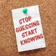 The phrase Stop Guessing Start Knowing on a piece ...