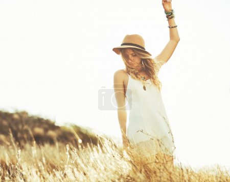 Photo for Fashion Lifestyle. Fashion Portrait of Beautiful Young Woman Outdoors. Soft warm vintage color tone. Artsy Bohemian Style. - Royalty Free Image