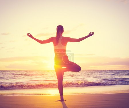 Yoga woman at sunset