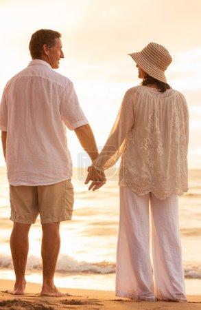 Mature Couple Holding Hands Enjoying at Sunset