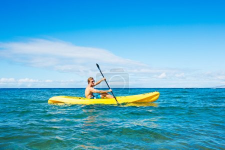 Man Kayaking in the Tropical Ocean