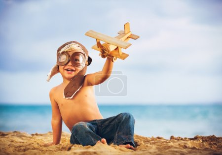 Small Boy and toy airplane