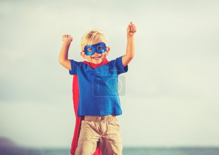 Superhero Kid playing