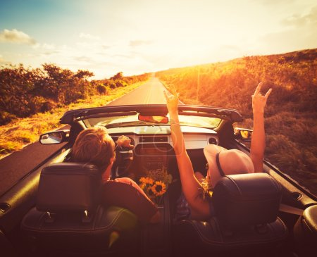 Couple Driving Convertable at Sunset