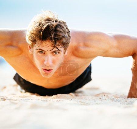 Male Athlete Exercising Doing Push-Ups