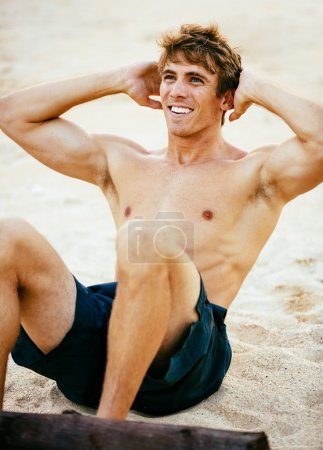 Man Doing Sit-Ups Outdoors on the Beach