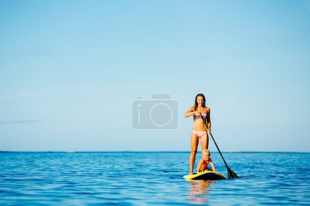 Mother and Son Stand Up Paddling Together