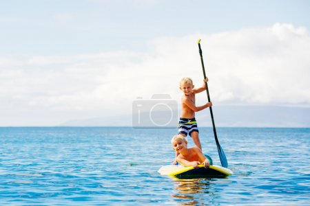 Boys Having Fun Stand Up Paddling