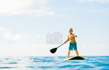 Young Boy Having Fun Stand Up Paddling
