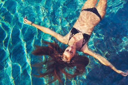 Woman Floating in Water Relaxing