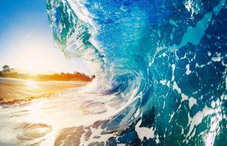 Photo for Blue Ocean Wave Crashing at Sunrise - Royalty Free Image