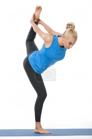 Athletic girl on gymnastic mat