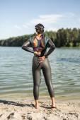 Girl in the swimrun suit outdoors