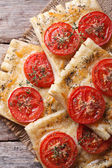 Puff pastry with tomato and cheese vertical. top view