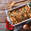 Mexican enchilada in a baking dish with the ingred...
