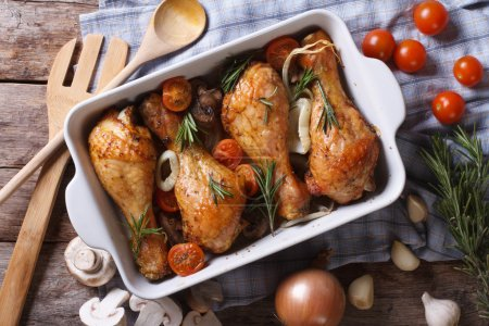 Photo for Baked chicken legs with vegetables close-up. horizontal view from abov - Royalty Free Image