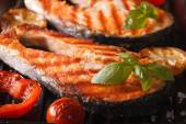 salmon steak and vegetables on the grill, macro. horizontal