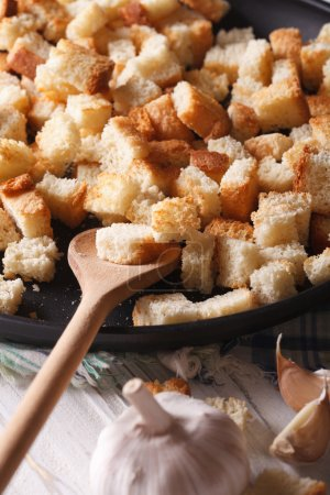 Homemade croutons with garlic macro. vertical rustic