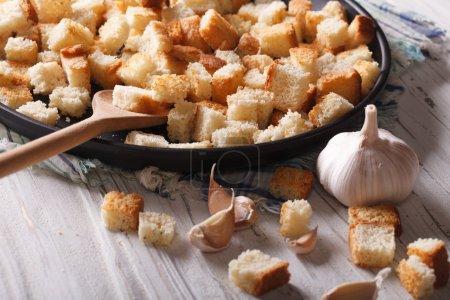 Homemade croutons with garlic macro.  Horizontal rustic