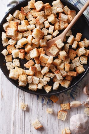 Homemade delicious croutons with garlic vertical top view