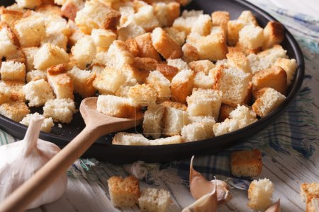 Homemade croutons with garlic close-up. Horizontal rustic
