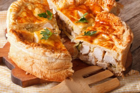 Photo for Chopped chicken pie close-up on the table. Horizontal, rusti - Royalty Free Image