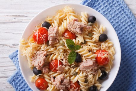 fusilli pasta with tuna, tomatoes and parmesan closeup. horizont