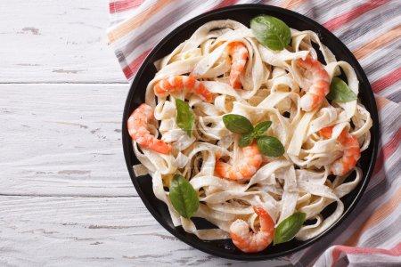 fettuccini pasta in cream sauce with shrimp. horizontal top view