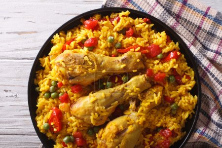 paella with chicken and vegetables closeup. horizontal top view