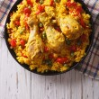 Spanish paella with chicken and vegetables on a pl...