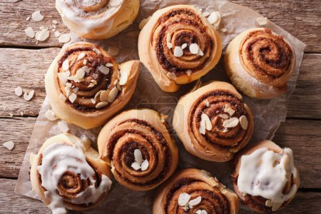 Glazed Cinnamon rolls with almond close up. horizontal top view