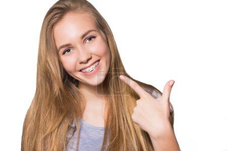 Portrait of teen girl showing dental braces.